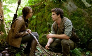 Lawrence, with Liam Hemsworth in &quot;Hunger Games&quot; - Lionsgate