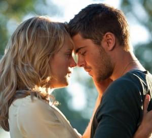 "Taylor Schilling and Zac Efron in ""The Lucky One"" (Warner Bros)"