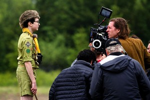 Wes Anderson (behind camera) directs actor Jared Gilman in MOONRISE KINGDOM