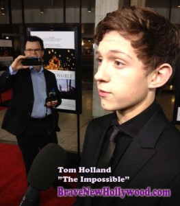 "Tom Holland at the Hollywood premiere of ""The Impossible,"" as dad snaps photos."