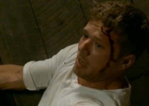 Ryan Phillippe is bloody in the face in this still from his directorial debut CATCH HELL