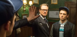 actors Colin Firth and Taron Egerton face the big mirror in the new  movie Kingsman The Secret Service