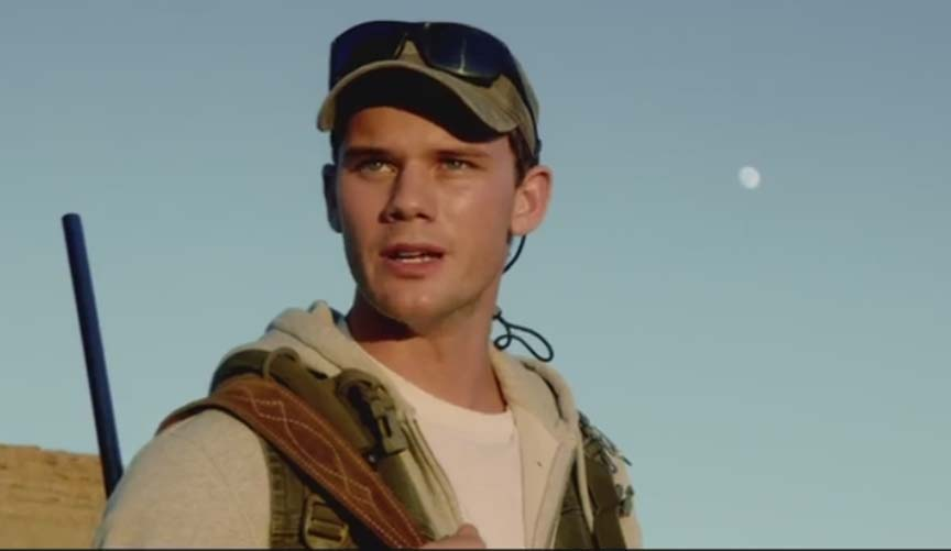 Jeremy Irvine (The Railway Man) falls prey to Michael Douglas' and his high-powered rifle in BEYOND THE REACH (2015)