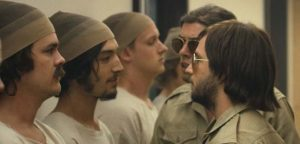 Actor Michael Angarano (R) intimidates Ezra Miller (L) - The Stanford Prison Experiment, IFC Films