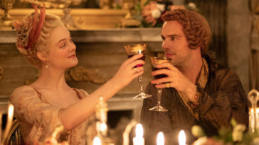 Actress Elle Fanning as EmpressCatherine the Empress of Russia and actor Nicholas Hoult as Peter, the Emperor drink a toast in The Great, a HULU TV series