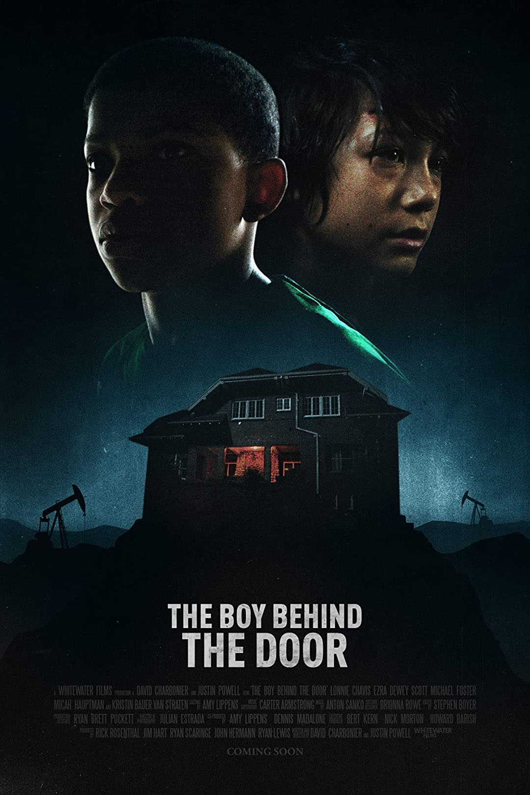 Young actors Lonnie Chavis and Ezra dewey grace the horror movie poster of The Boy Behind The Door